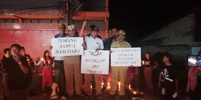 Masyarakat Kecamatan Dumoga Lakukan Aksi Seribu Lilin