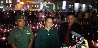 Relasi Pasang 1000 Lilin untuk Korban Tambang Busa Desa Bakan Bolmong