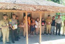 Bhabinkamtibmas Desa Buyat Bersama Tim Pelita Hati Berikan Pelayanan kepada Bayi Penderita Busung Lapar