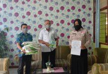 Dinkes Kotamobagu Serahkan Bantuan APD ke RS Kinapit dan RS Monompia