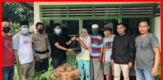 KADIN dan GP Ansor Kota Kotamobagu Bagikan Sembako kepada Warga