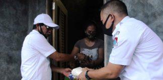Pemda Boltim Salurkan Bantuan kepada Masyarakat Terdampak Kirisis Ekomomi Pandemi Covid-19