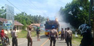 Sambut HUT ke-74 Bhayangkara, Polres Buol Gelar Penyemprotan Disinfektan di Pasar Kampung Bugis