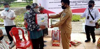 Pemkab Bolmong Salurkan Sembako kepada 173 Penyandang Disabilitas