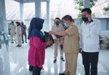 Pemkot dan BPJS Ketenagakerjaan Kotamobagu Serahkan Bantuan 200 Paket Bapok