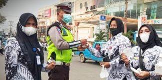 Memperingati HGN Tahun 2020, PGRI Kotamobagu Bagi-bagi Masker Gratis