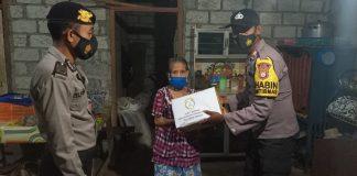 Bhabinkamtibmas Tolau Salurkan Bantuan Bhayangkari Cabang Buol