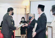 Bupati Bolmut Terima Penghargaan dari Kapolda Sulut