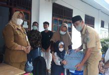 DPPPA Bolmong Salurkan Bantuan Untuk Anak Yatim Terdampak Covid 19
